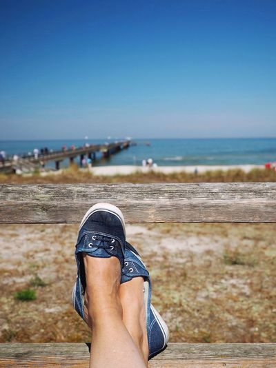 Human Body Part Sea Low Section One Person Personal Perspective Blue Human Leg Shoe Real People Beach Clear Sky Water Close-up Horizon Over Water Women Outdoors Day Nature Vacations Scenics