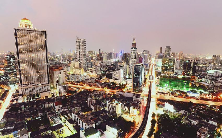 business buildings in Bangkok Bulding Bisness Nightphotography River Chowphaya River Thailand Long Exposure Road View Vibrant Color Skyscraper Illuminated City Cityscape Urban Skyline Night Modern Building Exterior Travel Destinations Stories From The City