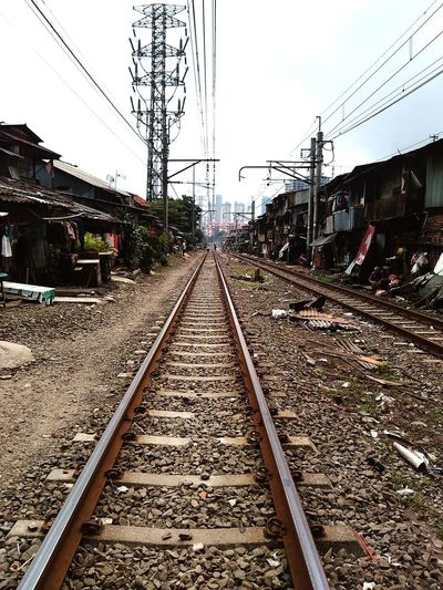 Q life in nearby train railroad, a place for sleep,eat,pray,make a living in corner jakarta