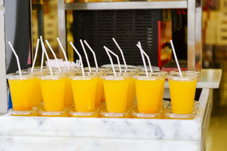 Orange juice in glasses on table