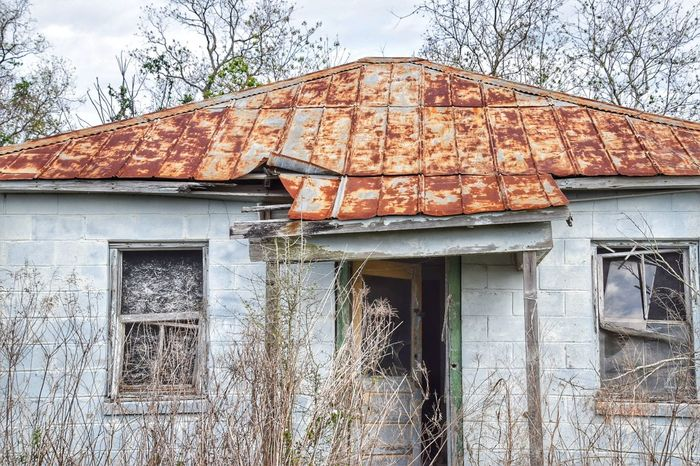 old building with tin roof Architecture Built Structure Building Exterior No People Outdoors Day Tree Sky Bad Condition Close-up Neglected Exteriorphotography Weathered Façade South Louisiana House Whitewashed Houses Rusted Metal  Rustic