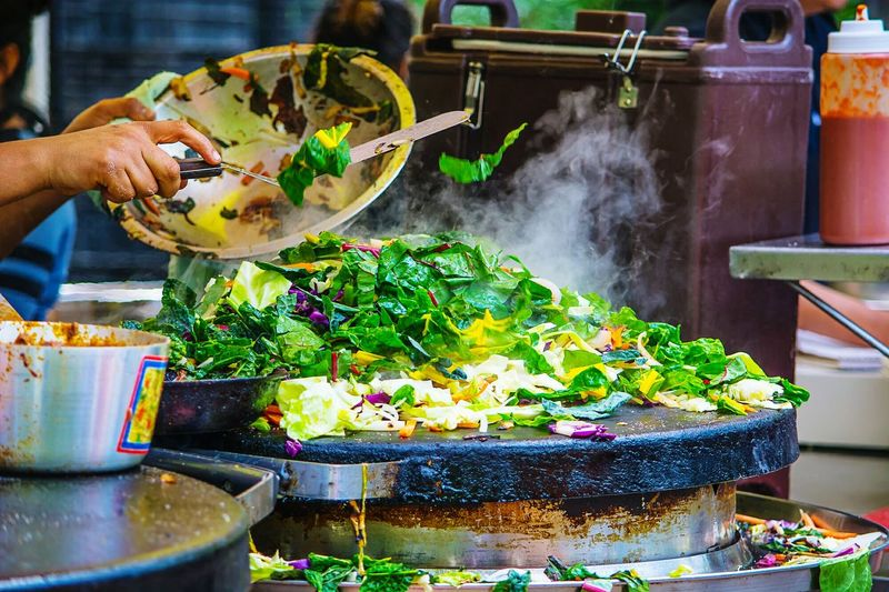 Cropped Image Of Chef Preparing Street Food At Market Stall