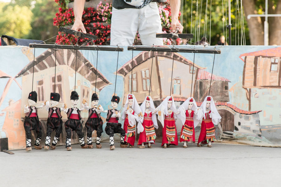 Art Culture And Entertainment Cultures Day Low Section Marionette Men Outdoors People Performance Puppeteer Real People Traditional Clothing Traditional Costume Traditional Dancing
