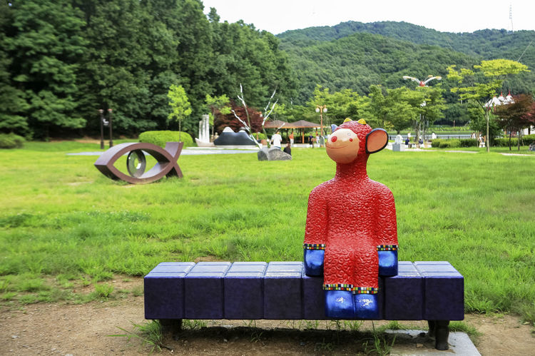Bench Boys Bundang Casual Clothing Childhood Field Full Length Grass Grassy Green Color Holding Leisure Activity Lifestyles Men Outdoors Park - Man Made Space Person Sitting Sunlight Tree Yuldong Park