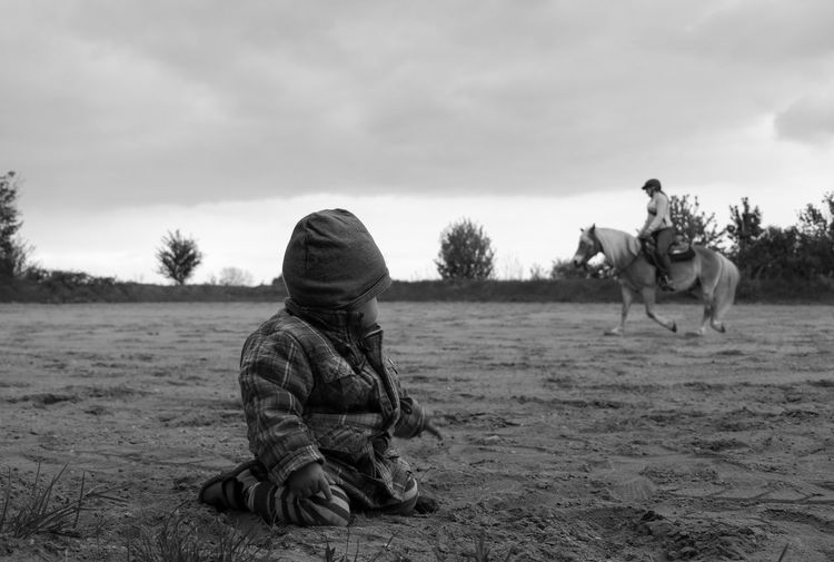 Adult Animal Themes B&W Magic Black And White Blackandwhite Child Childhood Day Domestic Animals EyeEm Best Shots Family Time Field Horse Horse Riding Live For The Story Boys Nature Outdoors People Real People Check This Out Sand Sky Togetherness Watching