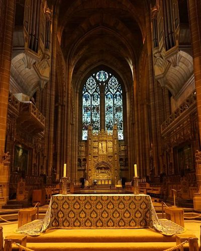 Liverpoolcathedral (6/6) Almost got it perfect..but someone wandered into shot! Grr. Cathedral Arch Architecture Symmetry Symmetricalmonsters Stainedglass Stainedglasswindows Dizzyingheights Dizzying Vaultedceilings Itsliverpool Visitliverpool Igersmersey Altar Pews Candle Fantasticbuilding Lowlight Goldenglow Flowers_and_more15 Fiftyshades_of_history Thepurist Nofilter