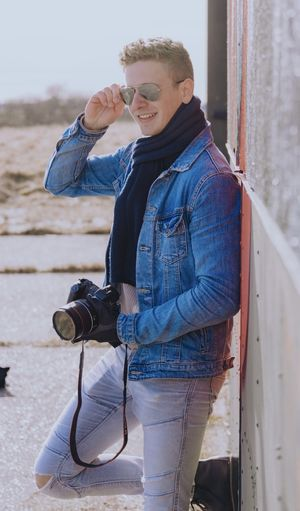 Full length of young man photographing with camera