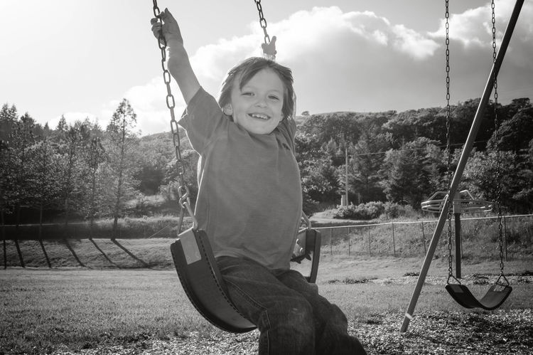 Happy Child  Swinging Hill Kid Kids Being Kids Lifestyles Playground Black And White Humboldt County Fun Chilhood Children Milo Back To School Swing Set