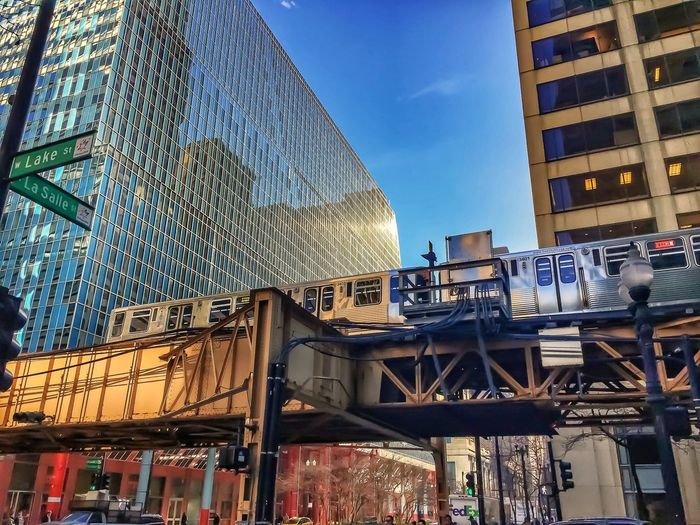 Lake and LaSalle stree corner in Chicago Loop with elevated train passing by overhead. Architecture Building Exterior Built Structure Low Angle View No People Sky Outdoors Day City City Life Cityscape Lake Street El Transit Transportation El Tracks El Train Elevated Train Elevated Track Chicago El Chicago Loop Downtown Chicago Chicago City Urban Architecture Mobility In Mega Cities