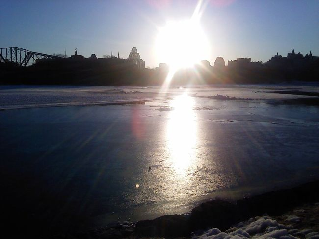Water Sun Sunlight Sunbeam Lens Flare Reflection Ottawa Ottawa Parliament Nature Scenics Tranquility Surface Level Shore Outdoors Day Beauty In Nature No People Mountain Backlit Sea Non-urban Scene Gatineau Quebec Museum