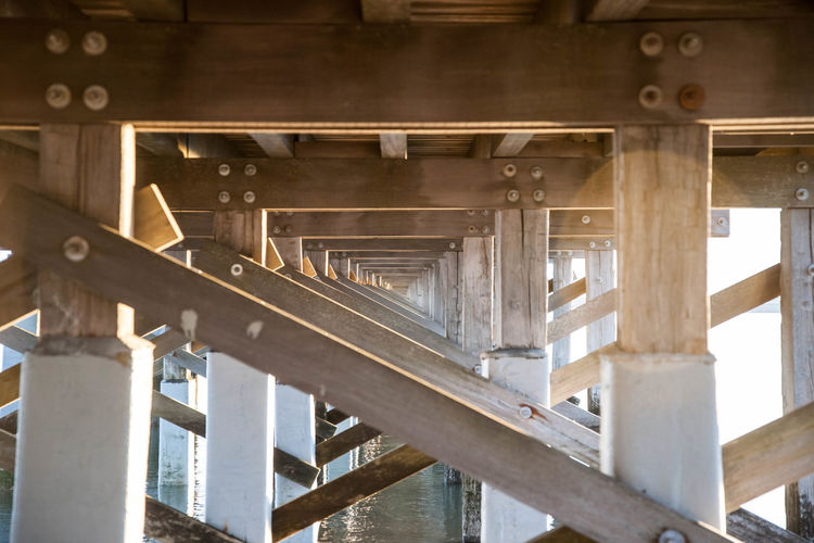 Standing Strong Architecture Bridge Bridge - Man Made Structure Built Structure Dux Engineering In A Row No People Pattern Powder_Point_Bridge Repetition Sunset SUPPORT Wood - Material