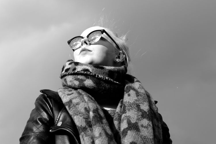 Low angle view of girl against clear sky