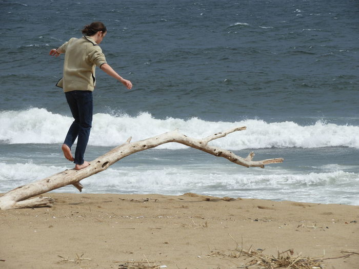 One Person Balancing On Driftwood One Person On Beach Ocean Beach Waves Coast Atlantic Ocean Nature Beauty In Nature Nature Photography Sand Dune Photography Beach Photography Water Full Length Sea Wave Beach Sand Shore Sandy Beach Acrobatic Activity Surf