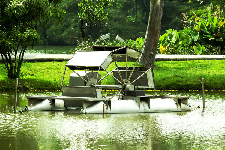 water turbine Bubble Maker For Water Water Turbine Water Turbine Controller Architecture Beauty In Nature Built Structure Day Floating On Water Gazebo Green Color Growth Lake Nature No People Outdoors Plant Reflection Rowboat Tranquility Tree Water Water Vane Water Wheel Waterfront
