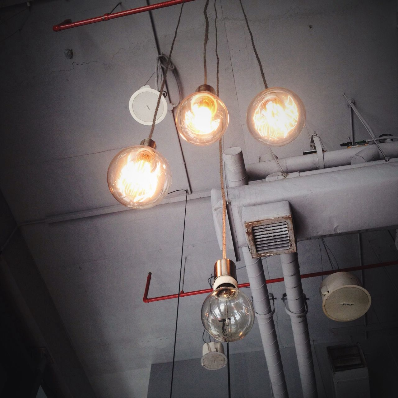 hanging, lighting equipment, electricity, light bulb, low angle view, illuminated, bulb, indoors, electric lamp, no people, electric light, filament, close-up, day