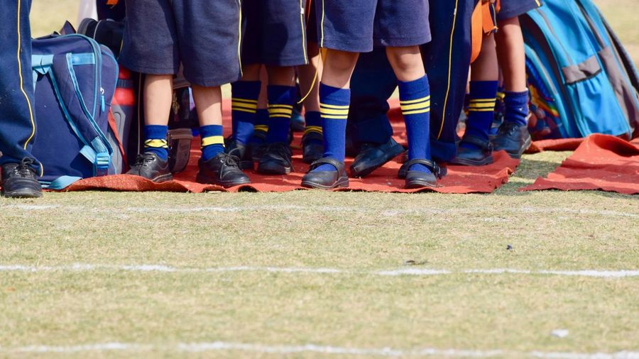 Group Of Boys On The Field Bags Blue Boys Field Green Group Of Students Outdoor Red Carpet School White Lines