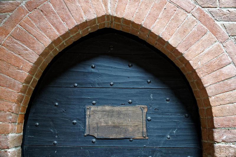 Arch Built Structure Architecture Entrance Wood - Material Door No People Building Exterior Day Closed Building Pattern Old Outdoors Wall Blue Wall - Building Feature Brick Security Brown Arched
