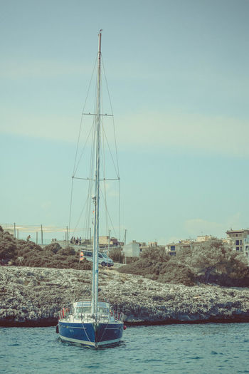 Nautical Vessel Transportation Water Sky Mode Of Transportation Sailboat Waterfront Mast Nature Pole Sea Day Sailing Outdoors Moored Travel Yacht Portrait Copy Space