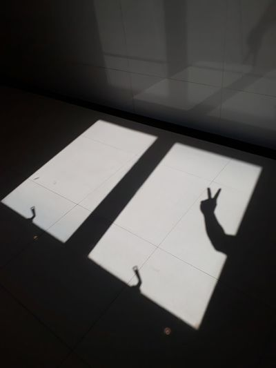 Shadow of person on tiled floor