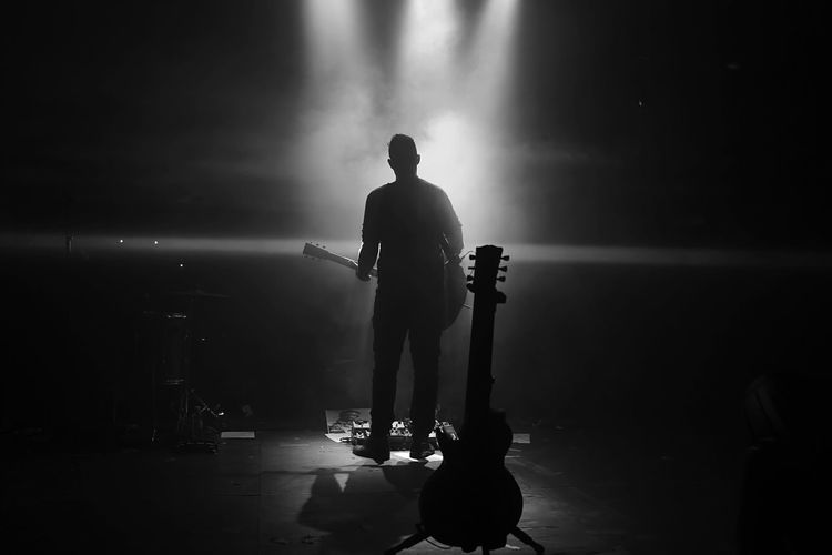 Real People Standing Rear View One Person Performance Musician Music Musical Instrument Guitar Guitarist Blackandwhite Music Festival Music Brings Us Together Concert Rock Rock