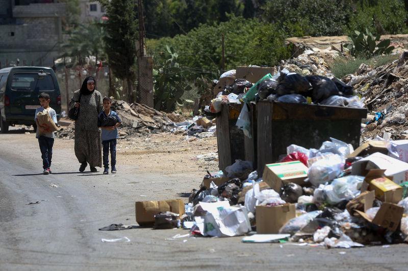 People on garbage bin