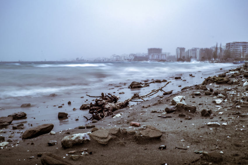 Albania Beach City City Cityscape Coastline Cold Temperature Day Environment Fog Long Exposure Nature Outdoors Rock Sand Sea Sky Tourism Tourism Destination Urban Skyline Water Waves Winter
