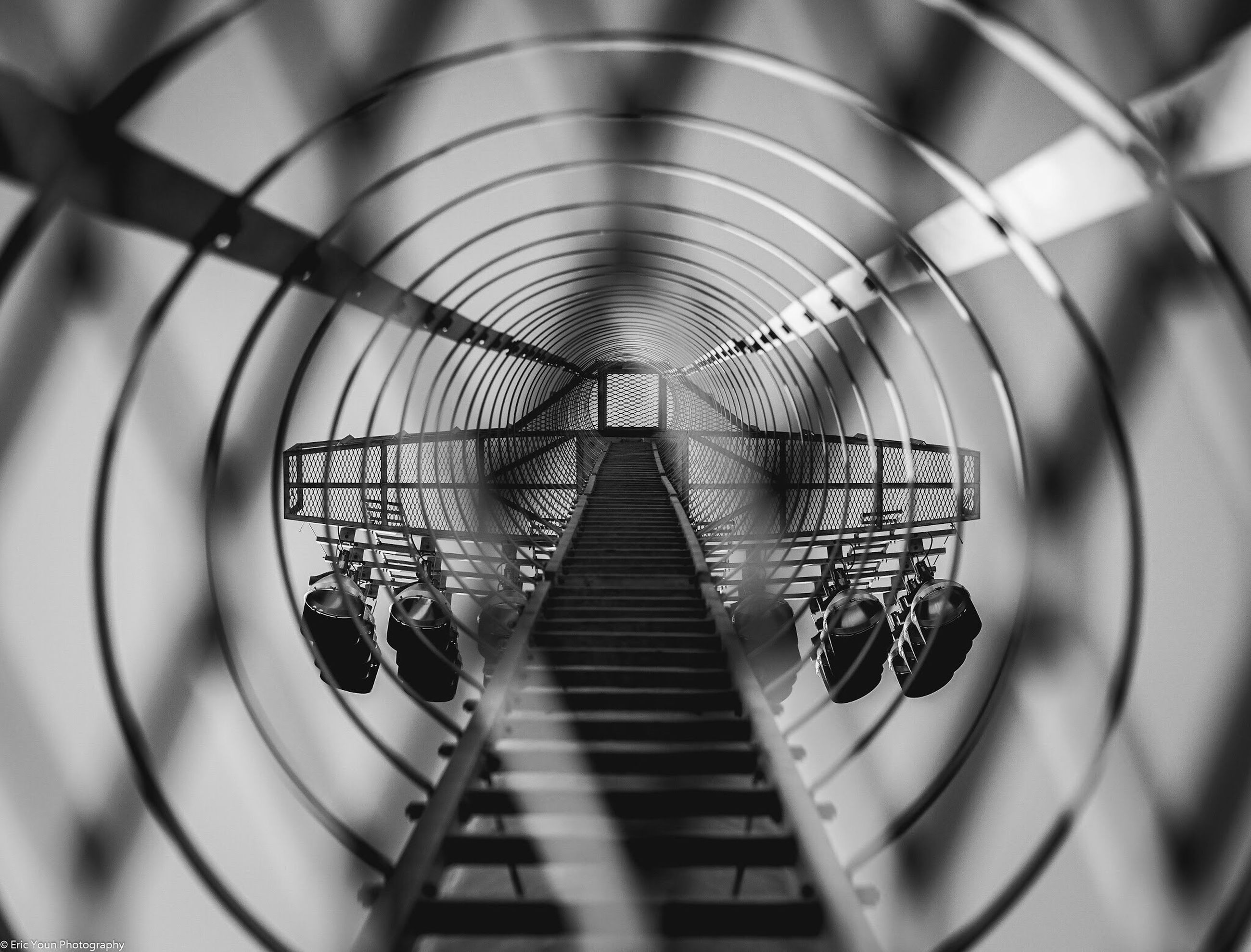 steps, indoors, steps and staircases, staircase, railing, metal, high angle view, built structure, architecture, pattern, escalator, stairs, spiral, the way forward, diminishing perspective, spiral staircase, day, no people, low angle view, ceiling