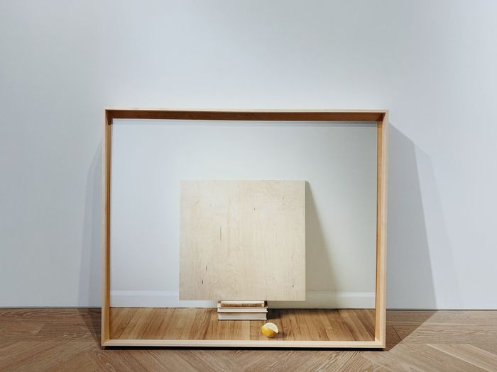 Wooden table against wall at home