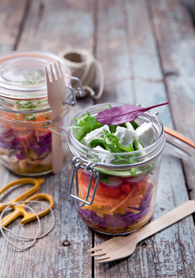 fresh salad in glass jar, takeaway healthy meal for healty living Healthy Eating Lifestyles Salad Carrot Gamba Red Pepers Beet Leaves Wood Natural Organic Scisors Food Srtyling Food Photography Jar Take Away Shick Freshness Yummy Glass - Material Wooden Fork