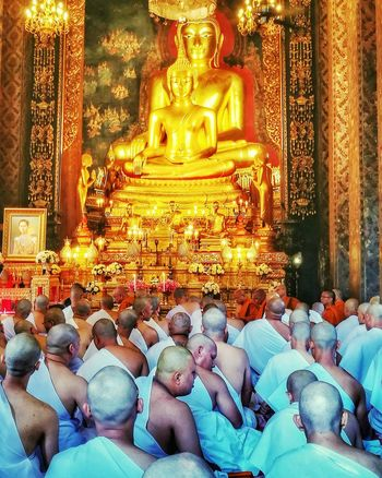 Religion Spirituality Praying Gold Colored Place Of Worship Ceremony Men Gold Large Group Of People Indoors  Statue Ordain Budhist Temple Budhism Spirituality
