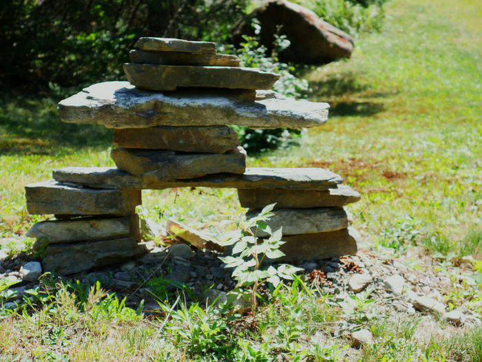 Close-up of stone stack on field