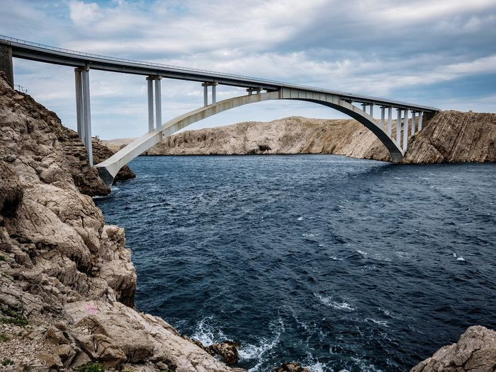 Rough sea with waves under a bridge. Rocky Coastline Waves Road Waves EyeEm Nature Lover EyeEm Best Shots Croatiafulloflife Water Horizon Bridge - Man Made Structure Steel Business Finance And Industry Metal Sky Architecture