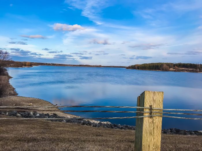 Water Sky Cloud - Sky Beauty In Nature Tranquility Tranquil Scene Scenics - Nature Lake Land Day Nature No People Blue Reflection Beach Non-urban Scene Barrier Outdoors Plant Wooden Post