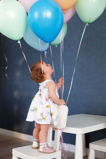 Rear view of girl with balloons