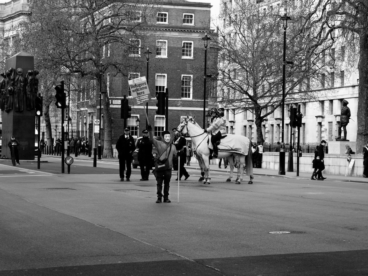 building exterior, architecture, built structure, city, real people, tree, large group of people, bare tree, outdoors, men, sport, day, people