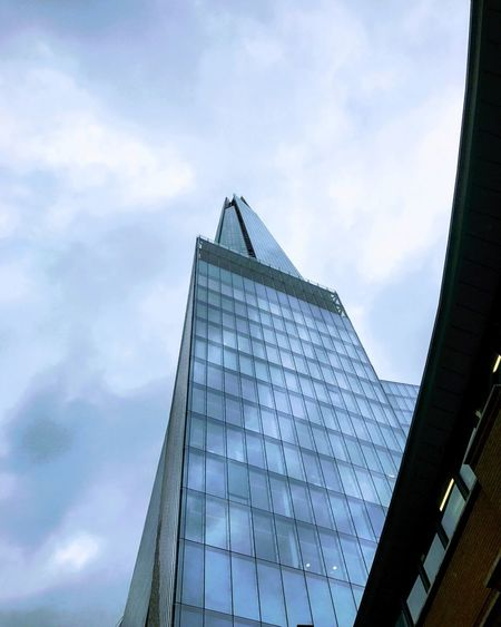 EyeEm LOST IN London Clouds gathering over the Shard. Low Angle View Architecture Sky Modern Built Structure Cloud - Sky Day Building Exterior Skyscraper No People Outdoors City