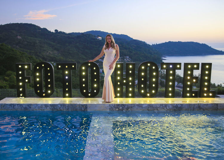 Bride in a white gown posing by the pool in Phuket, Thailand. Earrings Evening Gown Event Fashion Foto Hotel Infinity Pool Phuket Thailand View Wedding White Dress Aerial View Bikini Blonde Model Bride Bride Dress Bridegroom Girl Luxuru Model Posing Sexygirl Sunset Sunsets