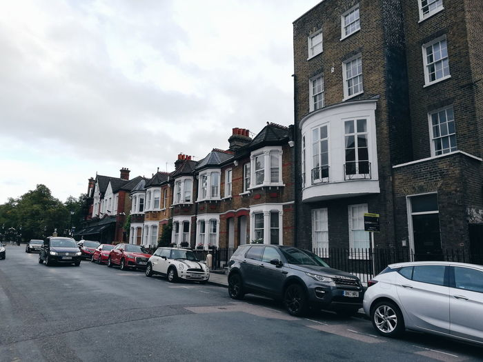 neighborhood, London, Sept 18'. London Londres Uk Houses Greenwich Home City Car Cityscape City Street Land Vehicle Police Force Sky Building Exterior Architecture Cloud - Sky Parking Stationary