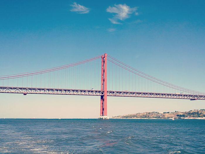 Ponte 25 de Abril Portugal Lisbon Rio Tejo River Ponte 25 De Abril Water Suspension Bridge Blue Beach Bridge - Man Made Structure Business Finance And Industry Pattern Clear Sky Sky
