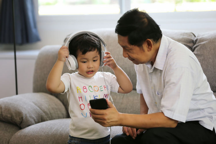 Childhood Child Family Men Males  Real People Bonding Family With One Child Parent Love Togetherness Indoors  Boys Casual Clothing Positive Emotion Emotion Innocence Son Care