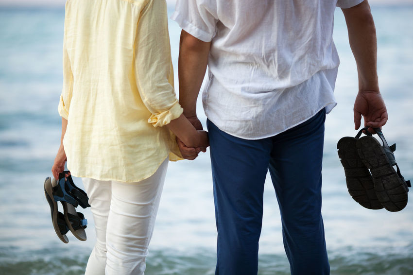 Beach Cauacasian Couple Hand Hold Man Ocean Outdoor Person Romantic Sea Shore Together Two Water Woman