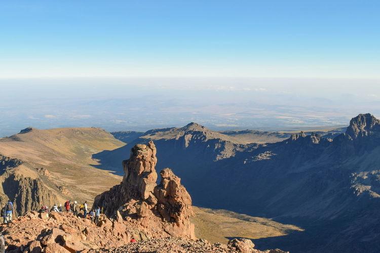 Scenic rock formations above the clouds at mount kenya, mount kenya national park, kenya