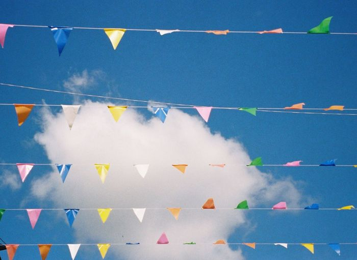 Colorful flag with sky background. Film Photography Sky And Clouds Sky Flag Colorful Flags Blue Multi Colored Bunting No People Hanging Decoration Nature Water Backgrounds Full Frame Outdoors Sport Sunlight Day Swimming Pool Flag Pool Motion In A Row