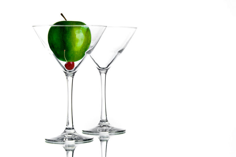 Glass White Background Alcohol Refreshment Food And Drink Studio Shot Drink Still Life Glass - Material Indoors  Drinking Glass Wineglass No People Transparent Copy Space Close-up Cocktail Household Equipment Freshness Green Color Martini Temptation Appletini