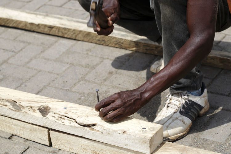 Low Section Of Man Hammering A Nail