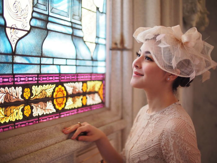 Woman looking at stained glass