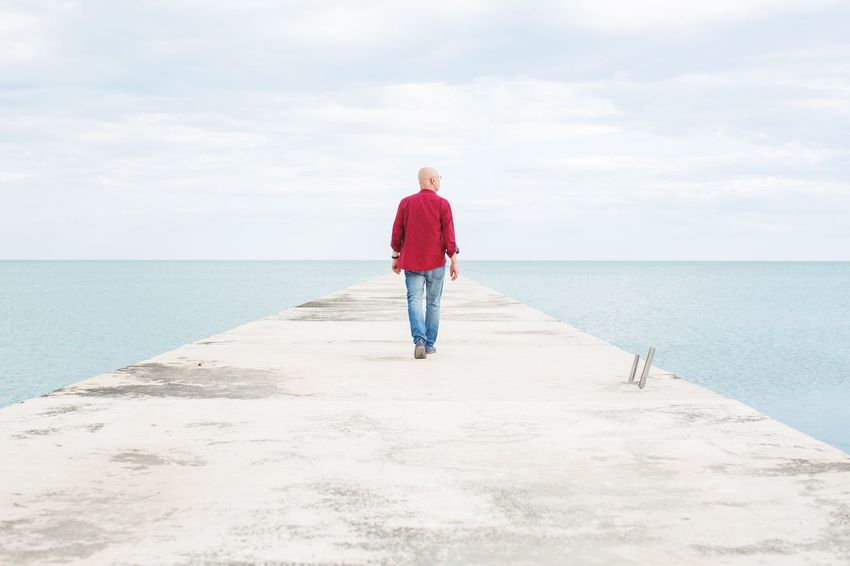 Sea Horizon Over Water Water Full Length Sky One Person Tranquil Scene Scenics Nature Beauty In Nature Leisure Activity Real People Tranquility Casual Clothing Day Rear View Outdoors Cloud - Sky Standing Beach Walking Walking Away Path Road Journey