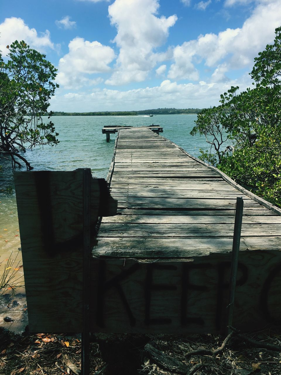 sky, water, sea, tranquility, nature, wood - material, day, cloud - sky, no people, tranquil scene, outdoors, sunlight, shadow, scenics, beauty in nature, horizon over water, tree