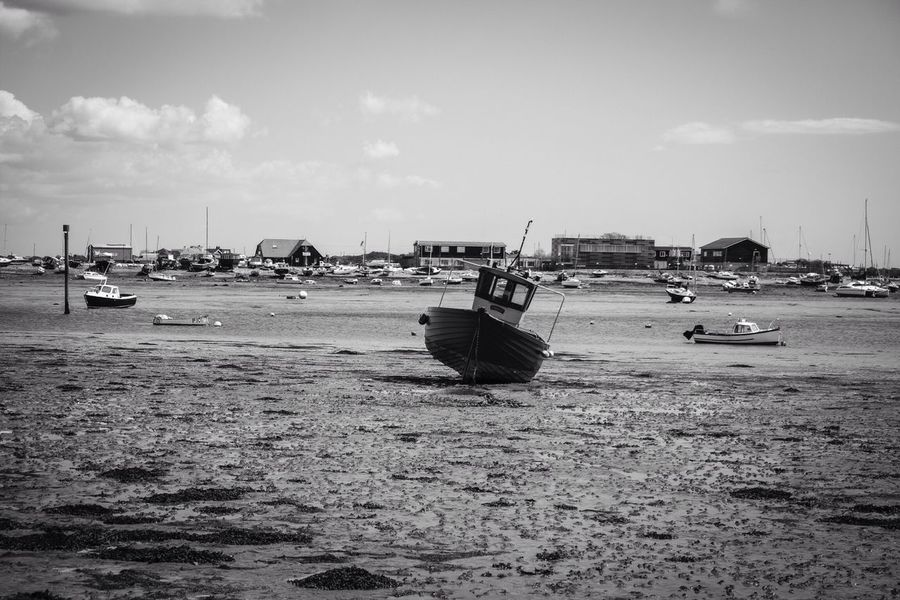 Boats resting on the Harbour bed at low tide B&W. Boats Harbour View Harbour Low Tide Sea B&w
