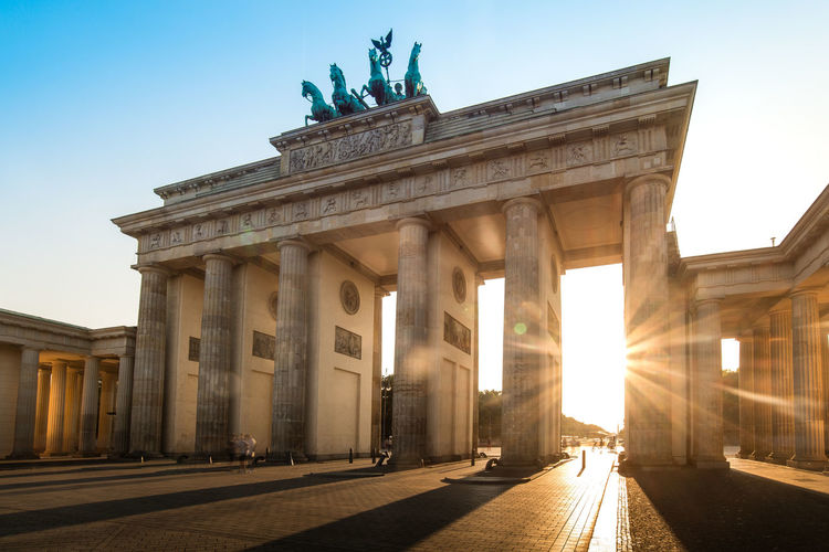 Brandenburg Gate in Berlin city, Germany Brandenburg Gate City Statue Architectural Column Politics And Government City Gate History Illuminated Sculpture Monument Cultures Memorial